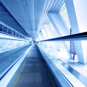 Fast moving escalator by motion — Stock Photo
