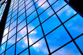 Clouds in glazed panel skyscraper — Stock Photo
