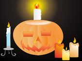 Pumpkins with candles — Stock Vector