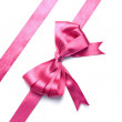 Pink ribbon with bow isolated — Stock Photo