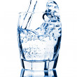 Water splashing into glass isolated — Stock Photo #3519581