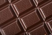 Dark chocolate block background — Stock Photo
