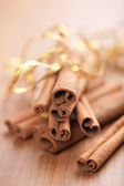 Cinnamon with golden ribbon — Stock Photo