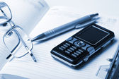 Organizer and mobile phone — Stock Photo