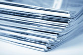 Stack of magazines toned blue isolated — Photo