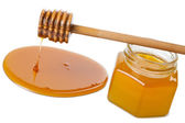 Wooden dipper with honey and bottle isolated — Stockfoto