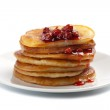 Sweet pancakes with strawberry jam isolated — Stock Photo #3591947