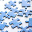 Blue puzzle pieces — Stock Photo