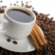 Stock Photo: Cup of coffee and roasted beans isolated