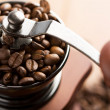 Roasted coffee beans in grinder — Stock Photo