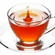 Tea splash in glass cup isolated — Stock Photo
