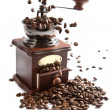 Coffee beans falling into grinder isolated — Stock Photo