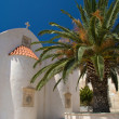 Greek church and palm against blue sky — Stock Photo
