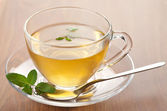 Cup of green tea with mint — Stockfoto