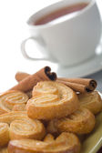 Spiced cookies and tea isolated — Stock Photo