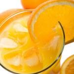 Glass of orange juice and oranges isolated — Stock Photo