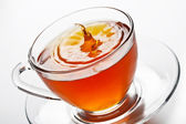 Tea splash in glass cup — Stock Photo