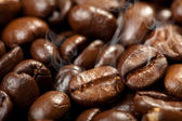 Hot roasted coffee beans background — Stock Photo