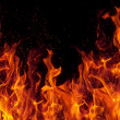 Fire isolated over black background — Stock Photo #3717756
