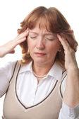 Senior woman with headache isolated — Stock Photo
