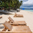Royalty-Free Stock Photo: Beach chairs on perfect tropical white sand beach in Boracay