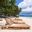 Beach chairs on perfect tropical white sand beach in Boracay — Stock Photo