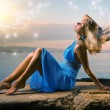 Sexy young woman relaxing near the ocean — Stock Photo #4744014