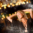 Beautiful young woman dancing late at night — Stock Photo #4744023