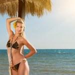 Beautiful young woman relaxing near the sea — Stock Photo