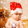 Adorable baby in Chrismtas hat - Stock Photo