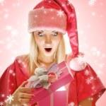 Mrs. Santa opening a gift box — Stock Photo #4744113