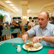 Man eating in a reastaurant — Stock Photo