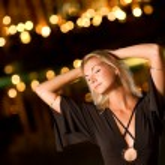 Beautiful young woman dancing late at night — Stock Photo #4744271