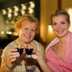 Two beautiful women celebrating — Stock Photo #4744278