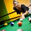Stock Photo: Beautiful blond womplaying billiards