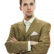 Handsome young groom in wedding suit over white background — Stock Photo