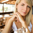 Beautiful young woman eating vegetarian food in a restaurant - Stock Photo