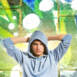 Royalty-Free Stock Photo: Cool looking man in a hood over abstract graffiti background