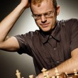 Thoughtful chess master - Stock Photo
