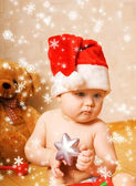 Adorable baby in Chrismtas hat — Stock Photo