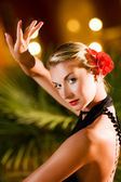 Beautiful young woman dancing tango — Stockfoto