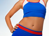 Fitness trainer body fragment — Stock Photo