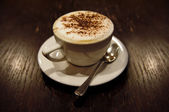 Cup of cappucino (toned in sepia) — Stock Photo