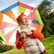 Beautiful little girl with colorful umbrella — Stock Photo #4783660