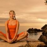 Beautiful young woman doing yoga exercise outdoors — Stock Photo