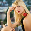 Sexy young woman sitting on a window-sill — Stock Photo