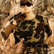 Stock Photo: Beautiful woman soldier with a sniper rifle