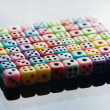 Plastic colorful dices over glass surface - Stockfoto