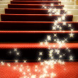 Stairs covered with red carpet — Stock Photo
