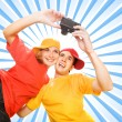 Stock Photo: Young couple photographing themselves